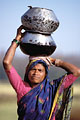Indian Woman. Carrying water for cooking